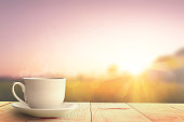 istock hot coffee and sunrise nature background 1189270493