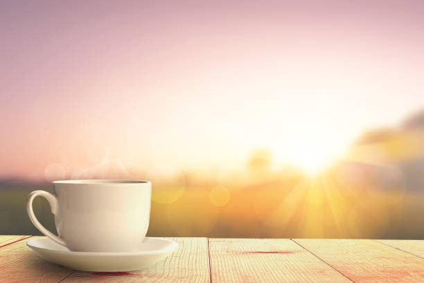 hot coffee and sunrise nature background hot coffee and sunrise nature background morning stock pictures, royalty-free photos & images