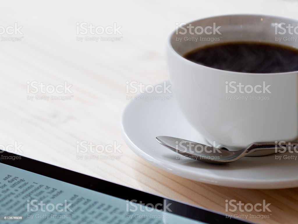Hot coffee and tablet PC ストックフォト