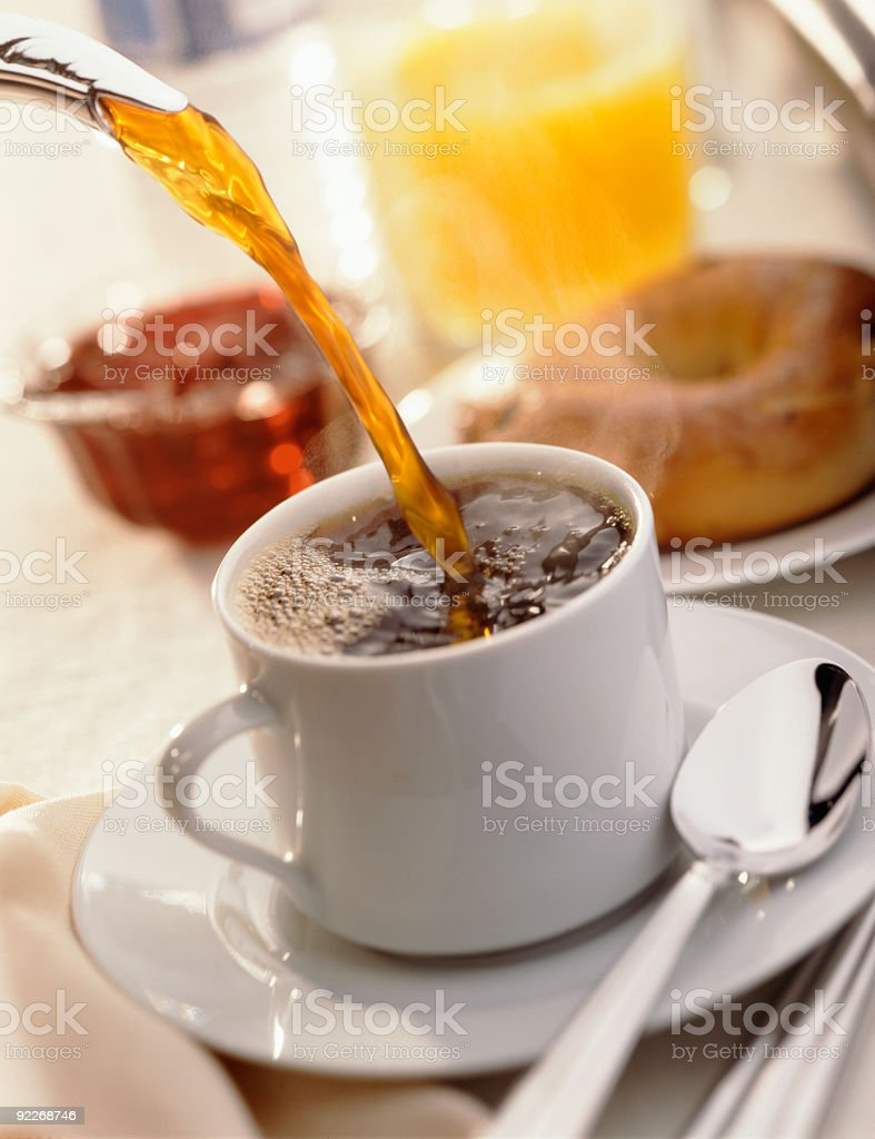 Hot coffee being poured into a white cup royalty-free stock photo
