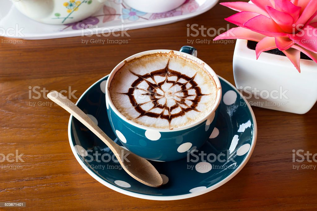 hot coffee cup on a wooden table stock photo