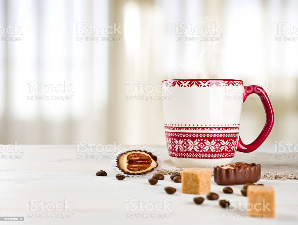 Hot coffee cup on table over blurred curtained window background stock photo