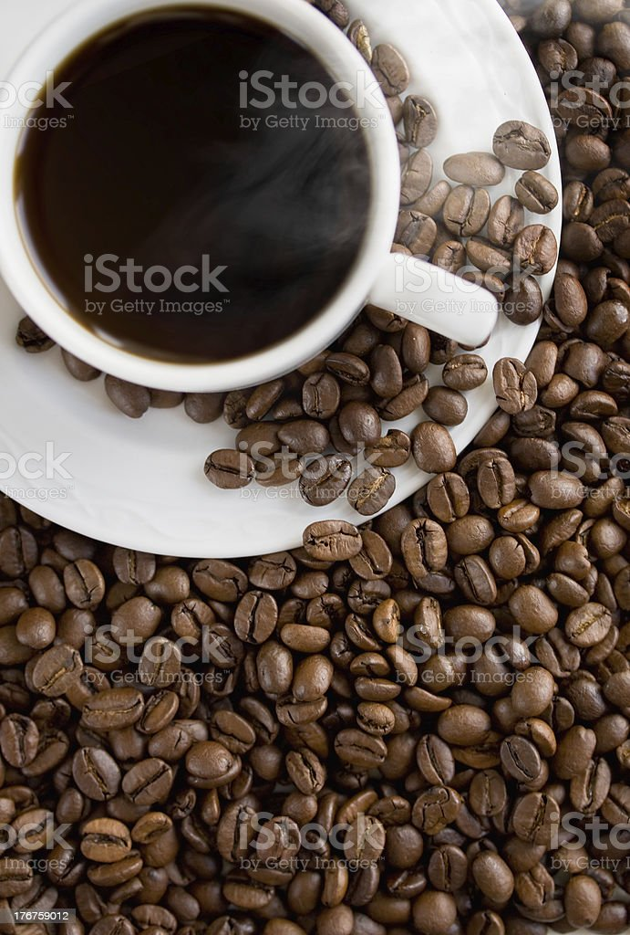 Hot coffee cup on the beans. royalty-free stock photo
