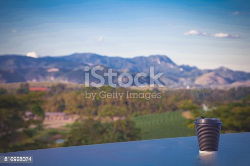 1135319558 istock photo Hot coffee cup with mountrian. 816968024