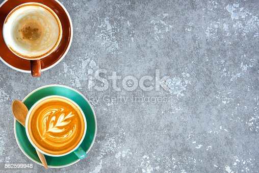 Hot coffee in a white cup on stone table board background.Top view.