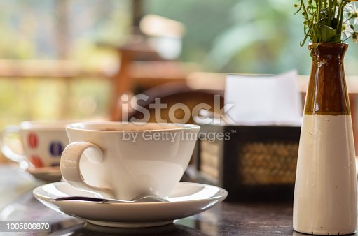 1078505838 istock photo Hot coffee in morning warm light. 1005806870