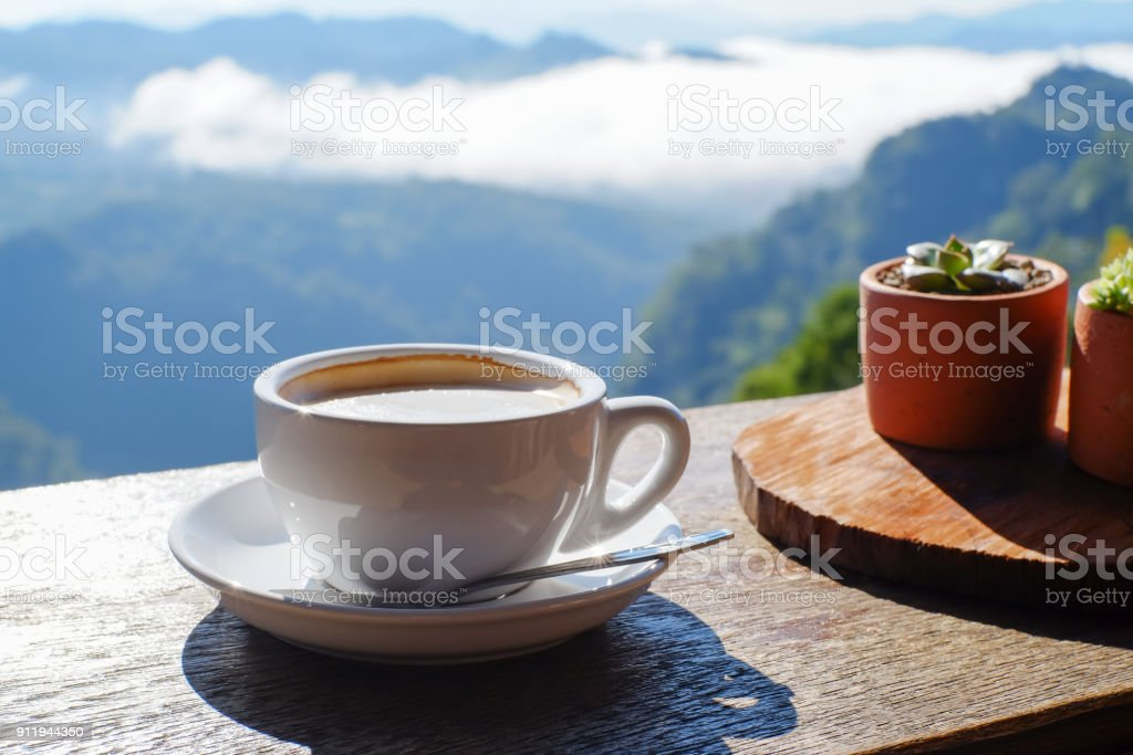 Hot Coffee in White Cup and Mountain stock photo