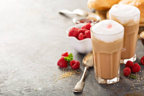 hot coffee latte with raspberry syrup - mocca stock-fotos und bilder