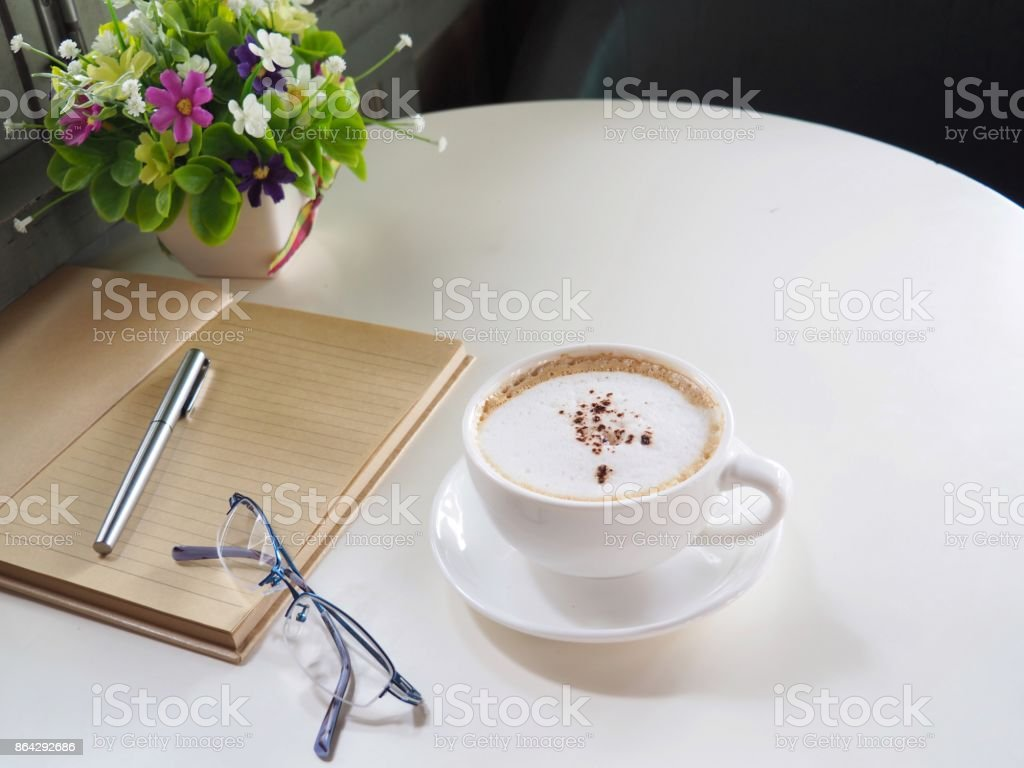 Hot coffee, notebook and pen royalty-free stock photo