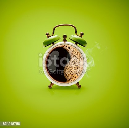 Photography of hot coffee in a retro alarm clock.