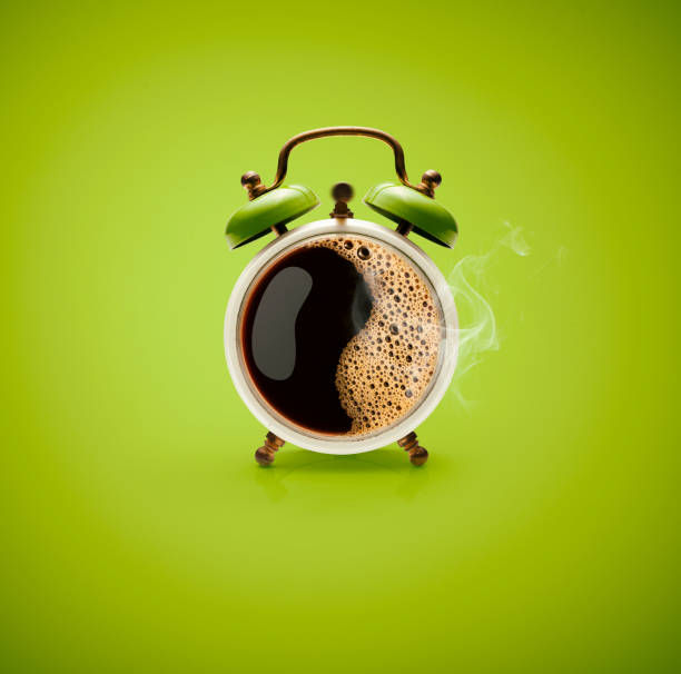 Hot Coffee Retro Alarm Clock Photography of hot coffee in a retro alarm clock. caffeine stock pictures, royalty-free photos & images