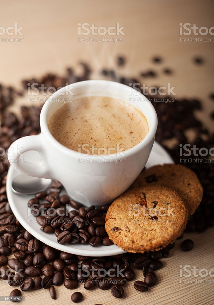 Hot coffee with cookies and beans royalty-free stock photo