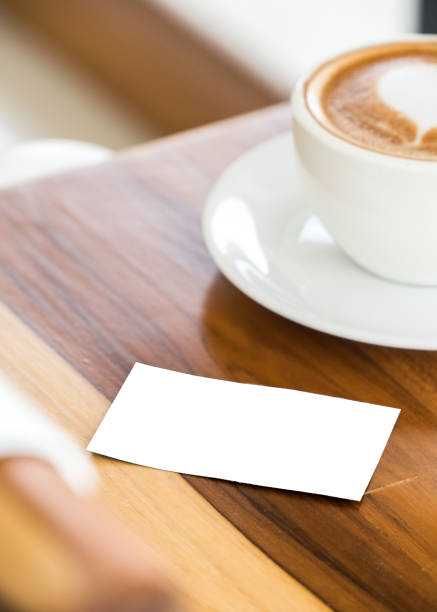 Royalty free heart shaped business cards pictures images and stock hot coffee with heart latte art shape on wood table stock photo colourmoves