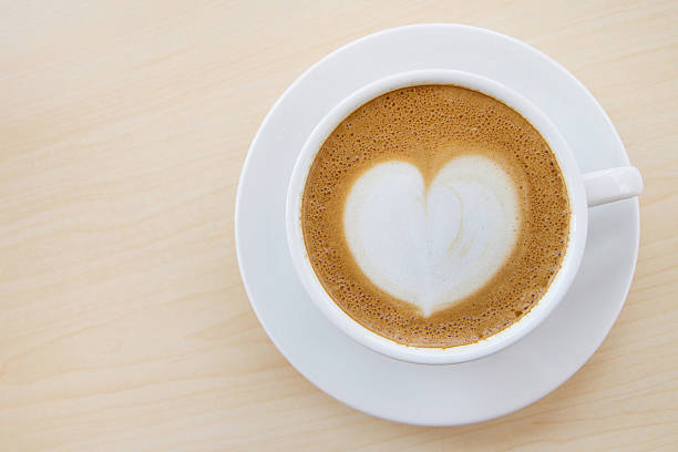 Hot coffee with heart pattern in white cup stock photo