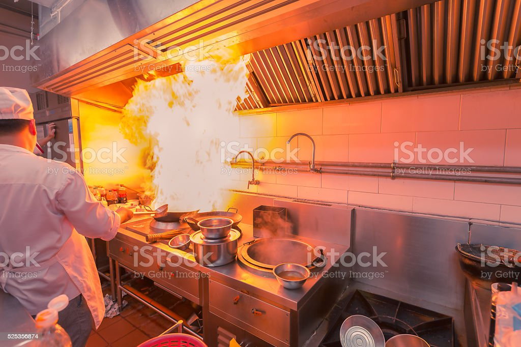 Hot cooking with chef stock photo