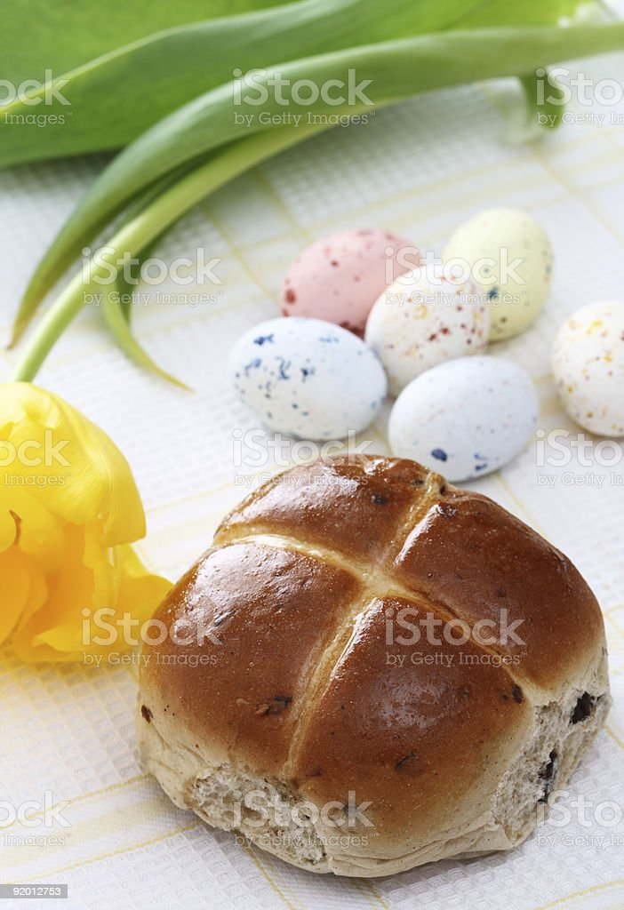 hot cross bun, Speckled easter eggs and yellow tulip royalty-free stock photo