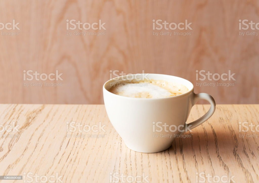hot cup of cappuccino coffee drink with wood table bacground stock photo