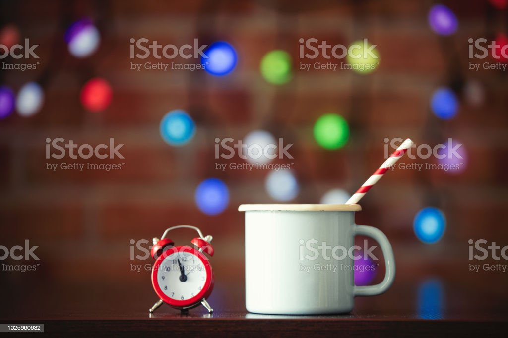 Hot cup of coffee and classic alarm clock stock photo