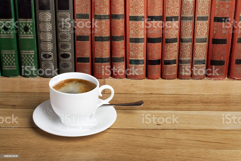 Hot cup of fresh coffee on the wooden table royalty-free stock photo