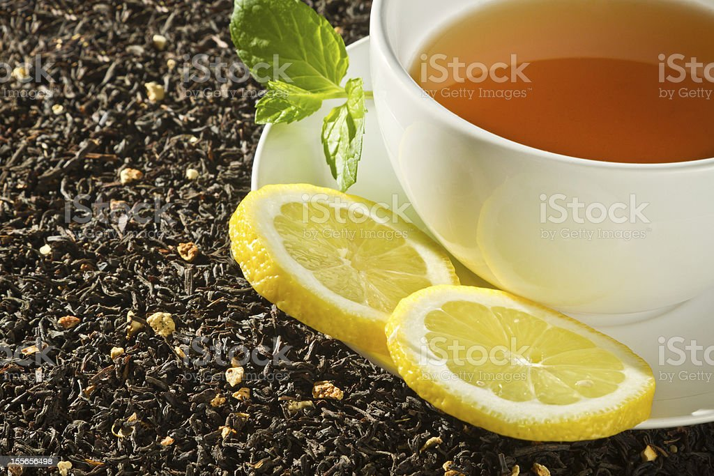 Hot cup of tea with lemon on grain background royalty-free stock photo