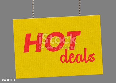 Cardboard Hot deal sign hanging from ropes. Clipping path included so you can put your own background