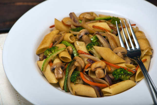 Hot dish of Penne Rigate noodles with Sauted Chopped Vegetables in Juliana. stock photo