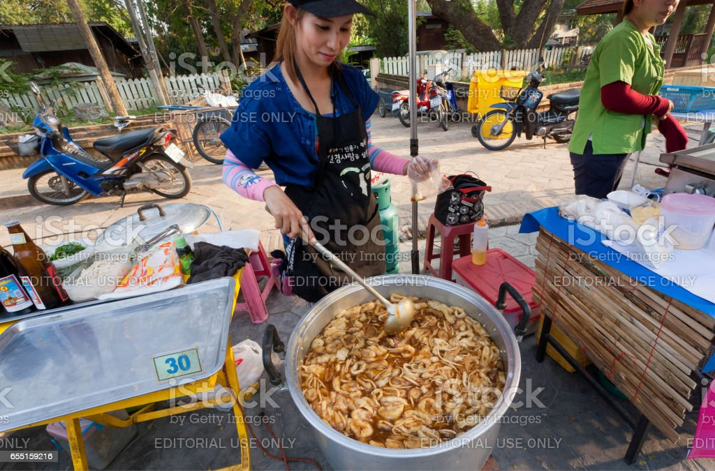 Hot dish with shrimps cooked for hungry visitors of street fair with fast-food court stock photo