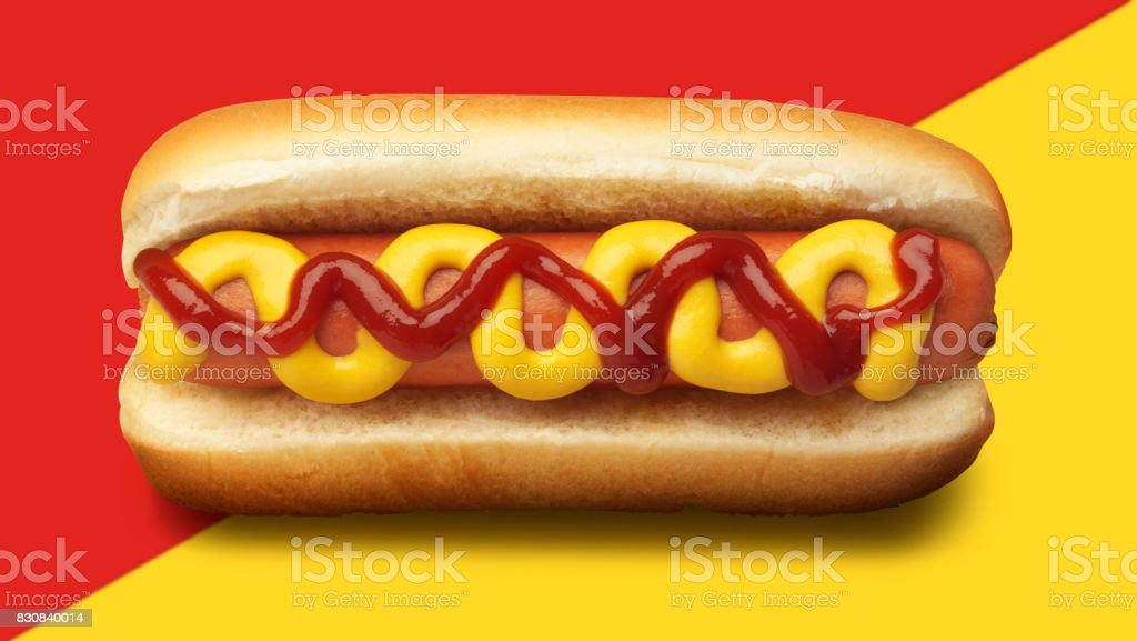 Hot Dog Garnished With Mustard And Ketchup On Red And Yellow background stock photo