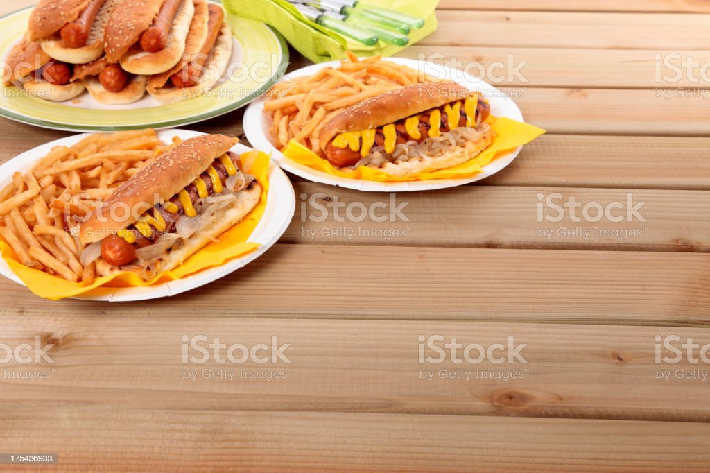 BBQ hot dog on the picnic table royalty-free stock photo