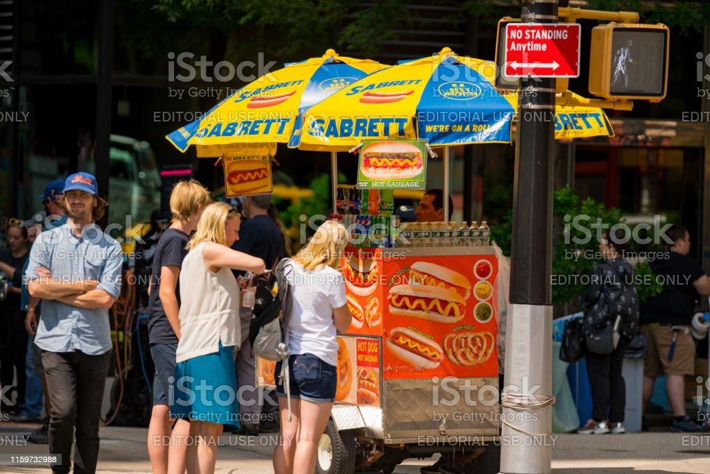 Hot dog stand Manhattan New York City Manhattan, NY, USA - June 22, 2019: Hot dog stand Manhattan New York City Buying Stock Photo
