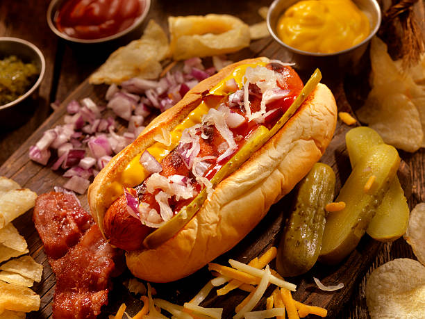 hot dog with all the fixings - hot dog stock pictures, royalty-free photos & images