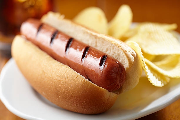 hot dog with chips - hot dog stock pictures, royalty-free photos & images