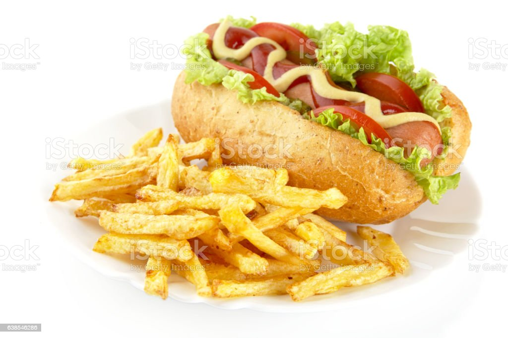 Hot dog with french fries on a plate on white stock photo