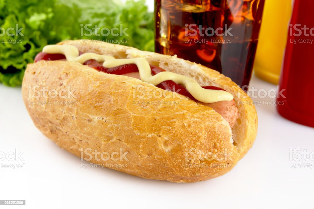 Hot dog with ketchup and mustard with salad with cola stock photo