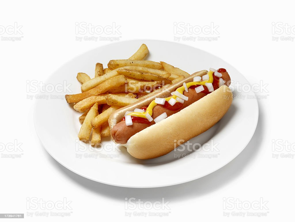 Hot Dog with Ketchup, Mustard, Onions and French Fries royalty-free stock photo