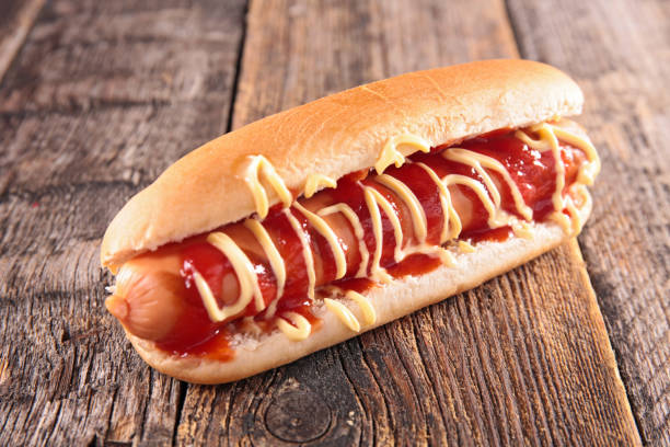 hot dog with mayo and ketchup stock photo