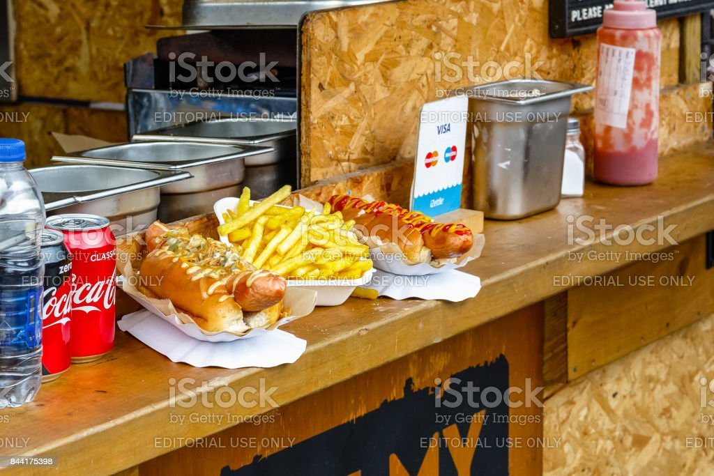 Hot dogs and chips on display at Camden Market in London stock photo