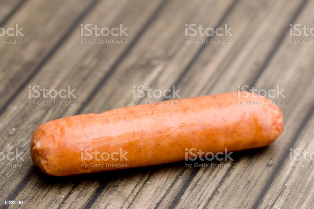 Hot Dogs Isolated on a Wooden Table stock photo