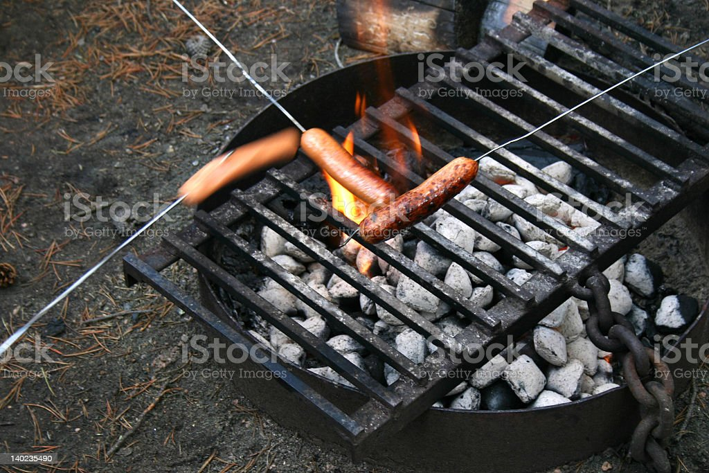 hot dogs on a grill royalty-free stock photo