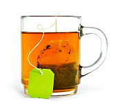 Cup of tea with tea bag and copy space, isolated on white background. Hot drink, herb tea or assam or earl grey tea. Cut out object.