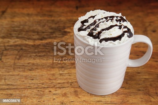 Hot Drink in a Mug with Whipped Cream on a Wooden Table