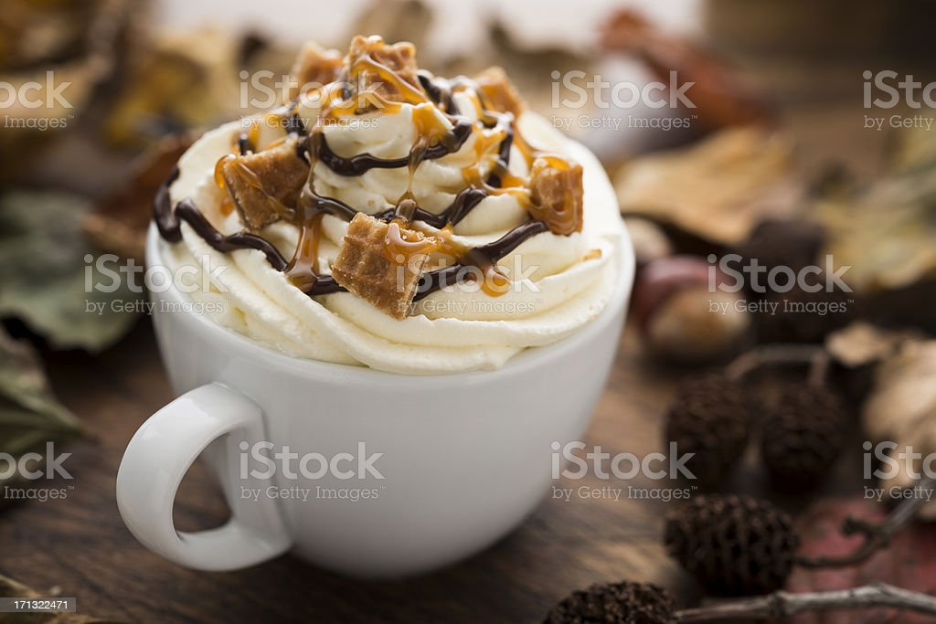 Hot drink with Cream, Caramel Waffle pieces and Chocolate sauce stock photo