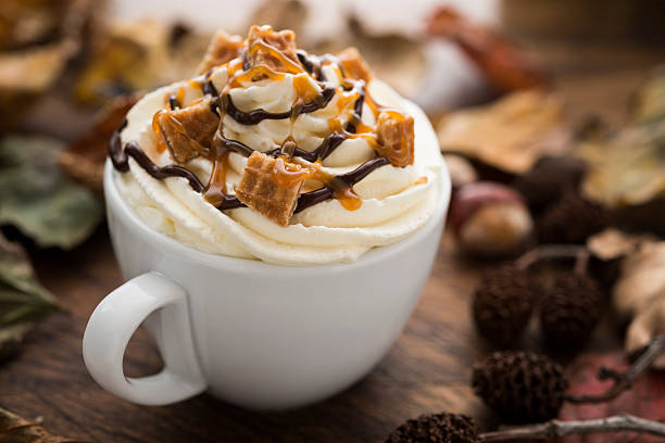 hot drink with cream, caramel waffle pieces and chocolate sauce - chocolate syrup stock photos and pictures