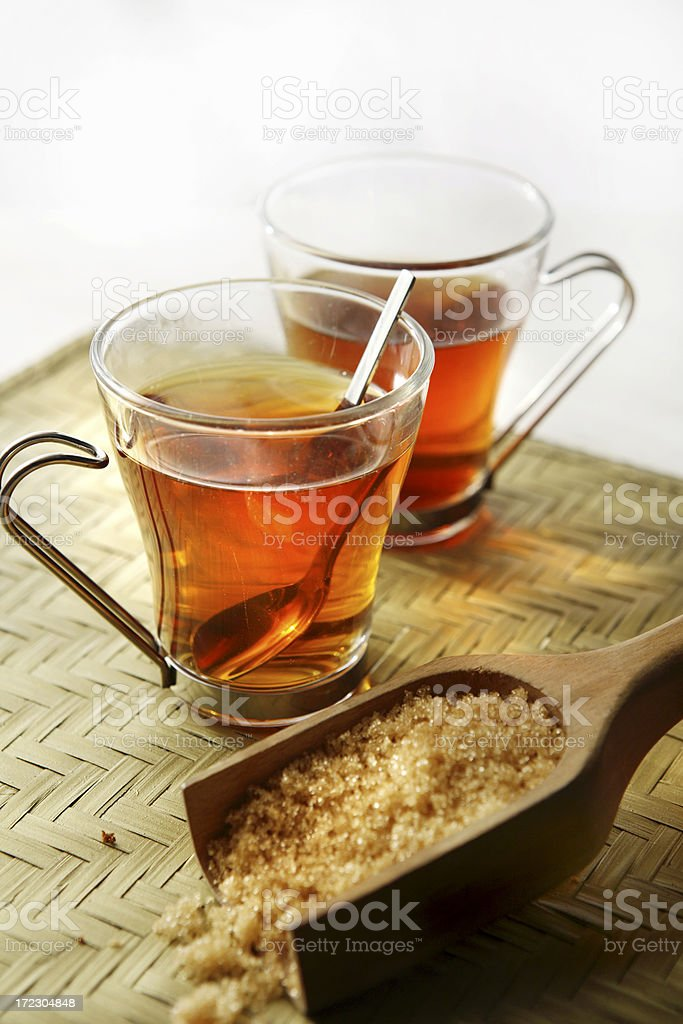 Hot Drinks: Two Tea Glasses and Cane Sugar Still Life royalty-free stock photo