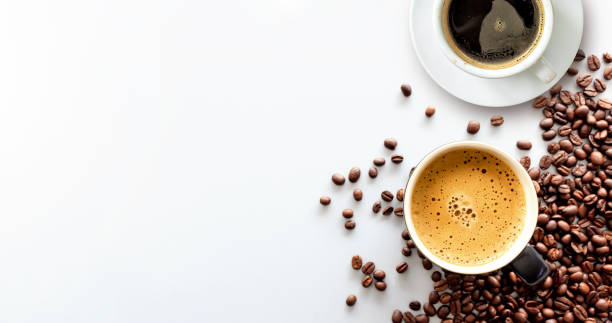 hot espresso and coffee bean on white table with soft-focus and over light in the background. top view – zdjęcie