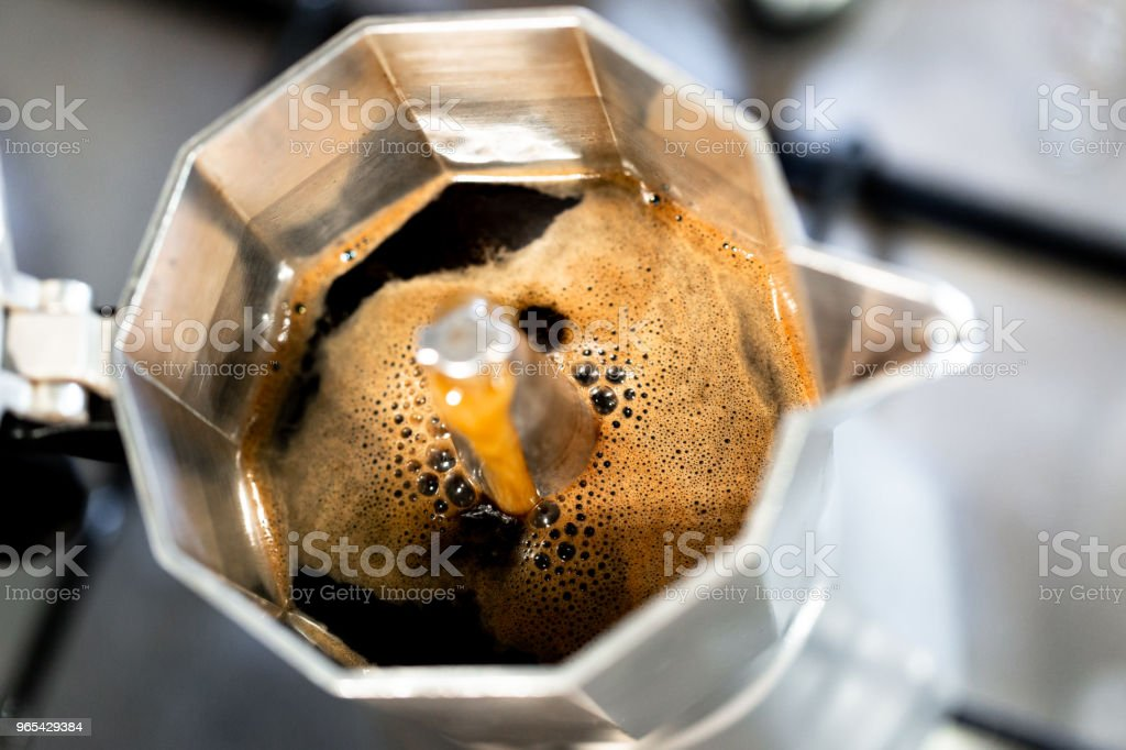 Hot fresh made coffee in Italian style mug close up view royalty-free stock photo