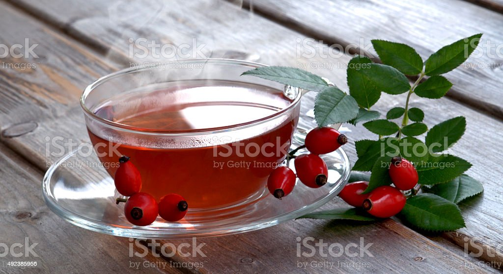 Hot fruit tea with rose hips for cold days stock photo