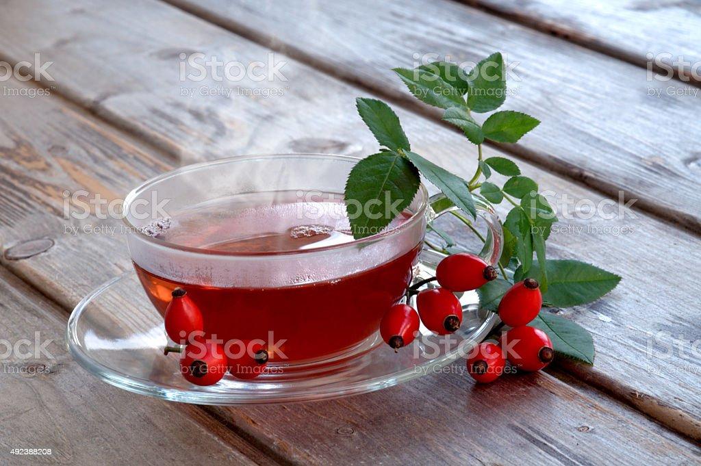Hot fruit tea with rose hips stock photo
