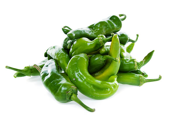 hot green chili peppers - green chilli pepper stock photos and pictures