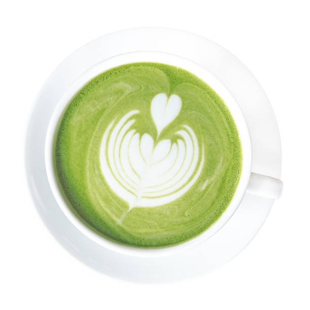 Hot green tea matcha latte cup with beautiful milk foam latte art on top isolated on white background, clipping path included. stock photo